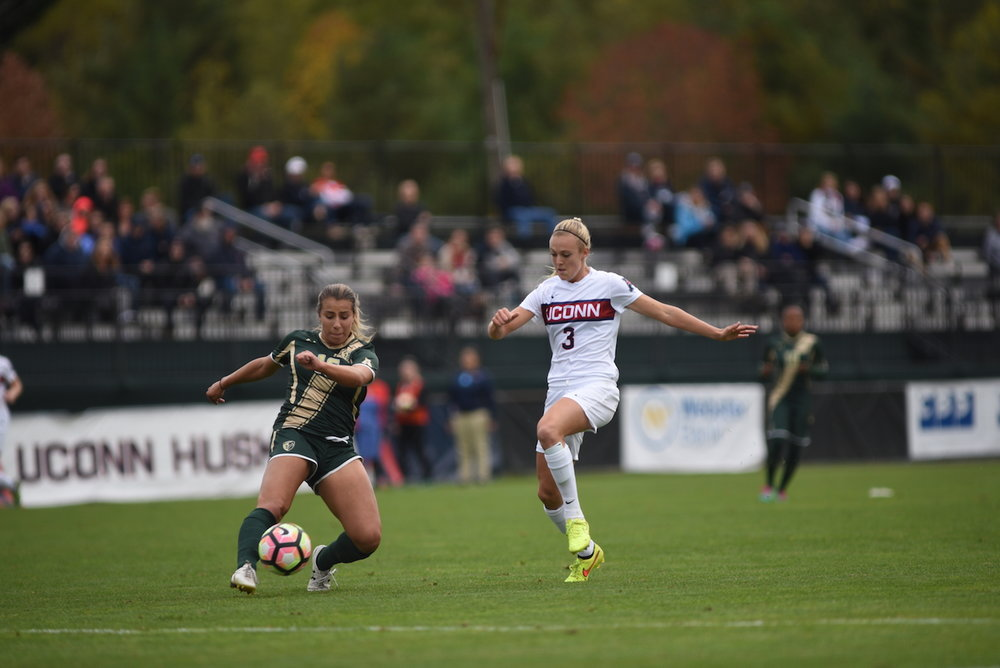 UConn's Rachel Hill (#3) moves in on a USF player for the ball in a game on Oct. 16, 2016. The Huskies win 3-1. (Charlotte Lao/The Daily Campus)