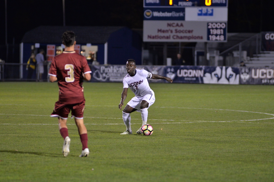 UConn senior midfielder Kwame Awuah makes a move on BC defender Younes Boudadi (#3) in the Huskies' 1-0 overtime win on Tuesday Oct. 18, 2016 at Morrone Stadium.
