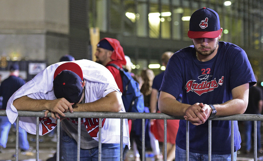 Cleveland Indians fans Levi Jones, left, and Kyle Zabarsky react during a watch party, after Game 7 of the baseball World Series between the Indians and the Chicago Cubs, outside Progressive Field, early Thursday, Nov. 3, 2016, in Cleveland. The Cubs won 8-7 to win the series. (David Dermer/AP Photo)