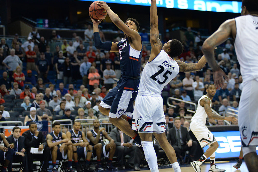 Jalen Adams attacks the basket and goes up for a layup during UConn's 104-97 four overtime victory over Cincinnati in the quarterfinals of the American Athletic Conference Championship at the Amway Center in Orlando, Florida on Friday March 11, 2016. Adams will be a key factor in the Huskies' success this year.