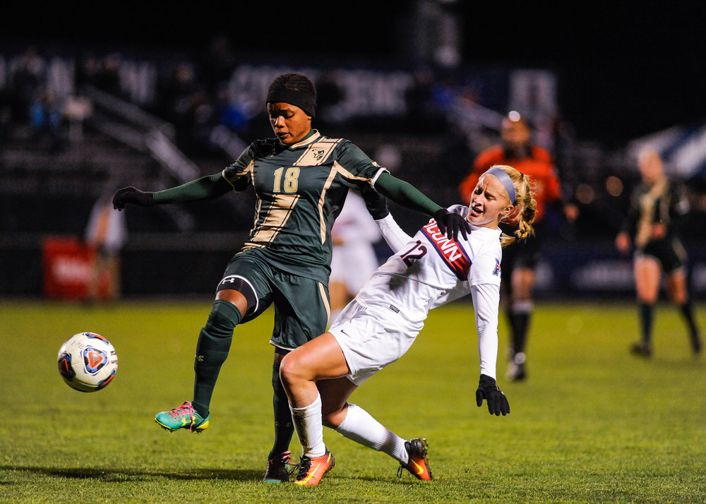 Sophomore defender Heidi Druehl battles a USF player during the Huskies' 2-0 victory on Friday, Nov. 4 at Joseph J. Morrone Stadium. UConn will play in the conference finals against SMU on Sunday. (Jason Jiang/The Daily Campus)