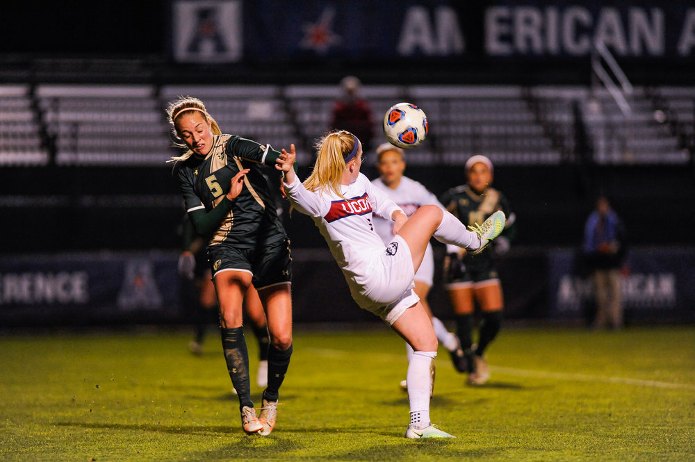 Senior midfielder/forward Rachel Hill twists to kick the ball away from a USF player during the Huskies' 2-0 win on Friday, Nov. 4 at Joseph J. Morrone Stadium. UConn advanced to the conference finals and will play SMU Sunday. (Jason Jiang/The Daily Campus)