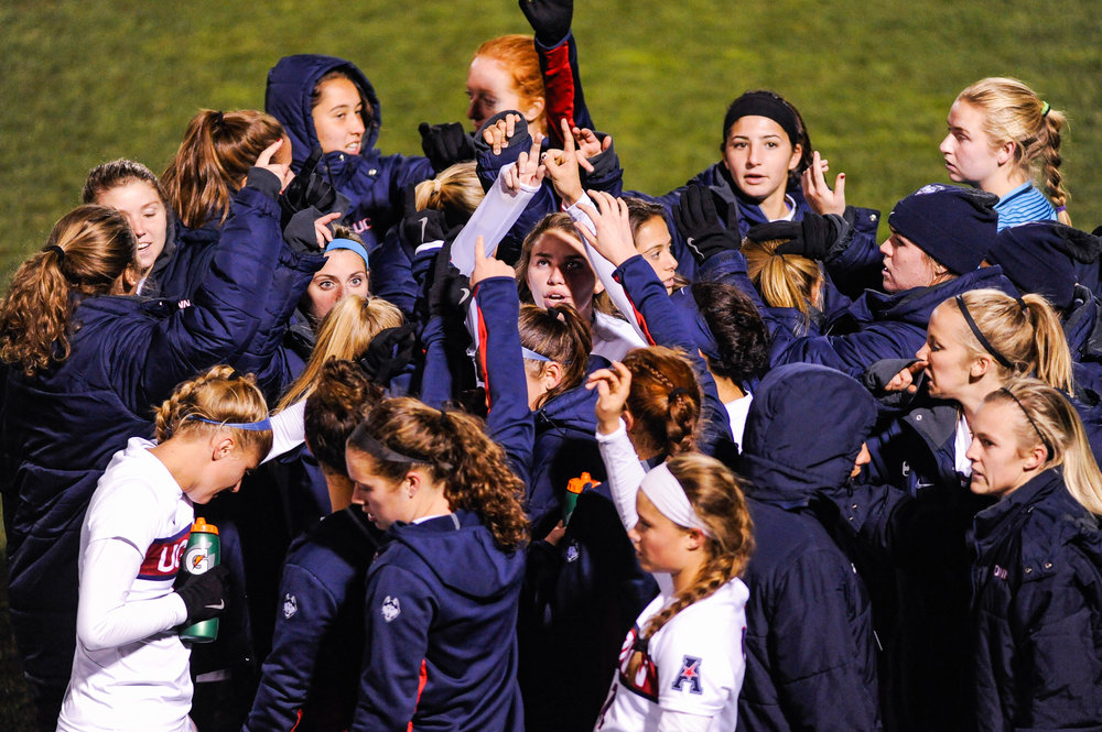 The UConn women's soccer team huddles before the AAC semifinal game against USF on Friday, Nov. 4 at Joseph J. Morrone Stadium. The Huskies won 2-0 and will advance to the conference finals against SMU, seeking their second-ever American Athletic Conference championship title. (Jason Jiang/The Daily Campus)