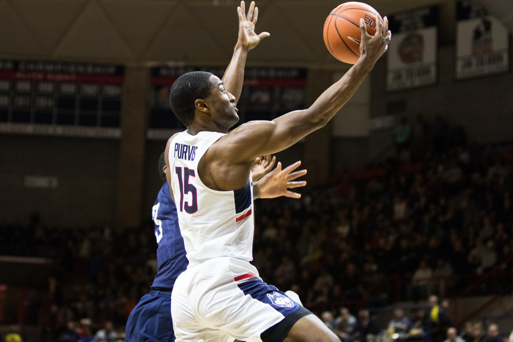 UConn's Rodney Purvis (15) drives to the hoop in the Huskies' 94-65 win over Southern Connecticut State University on Nov. 5, 2016 at Gampel Pavilion. (Jackson Haigis/The Daily Campus)