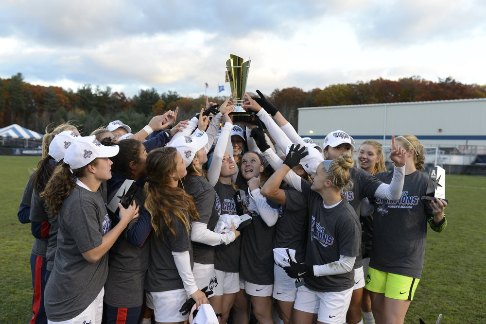 The UConn women's soccer team admires their trophy following a 1-0 victory over SMU on Sunday, Nov. 6 at Joseph J. Morrone Stadium. The Huskies took home their second American Athletic Conference title in program history. (Jason Jiang/The Daily Campus)