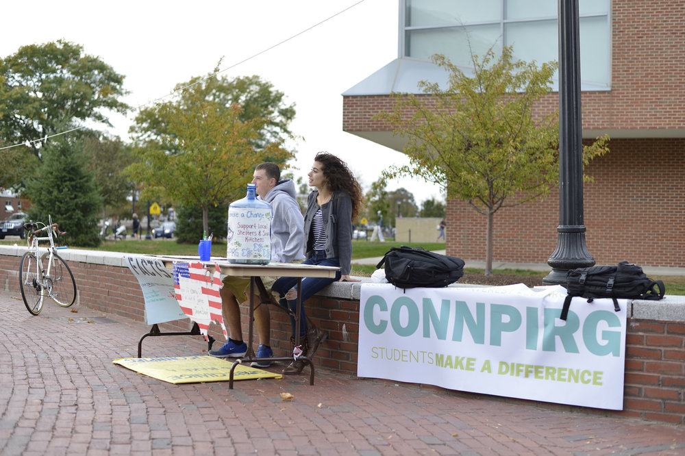 UConnPIRG tables on Fairfield Way in this undated file photo.  Student activist group wants students to know they reserve the option to waive the group's $5 per semester fee, present on University of Connecticut student fee bills.  (Jason Jiang/The Daily Campus)
