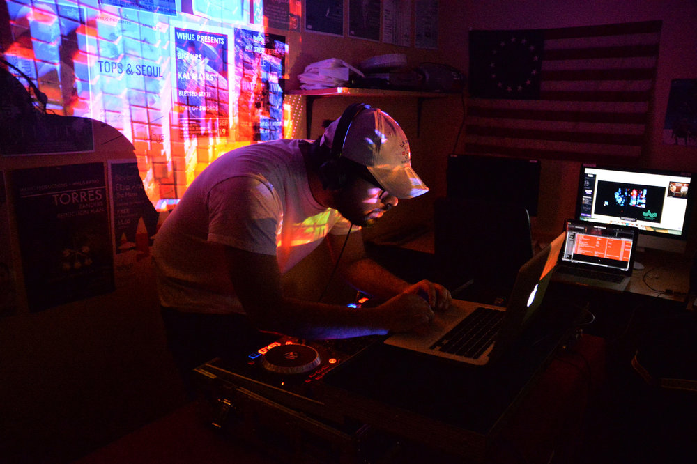 """A small group of locals have been working since May to bring the news program """"Democracy Now!"""" back on the air of WHUS, the University of Connecticut's student-run radio station. (Amar Batra/The Daily Campus)"""