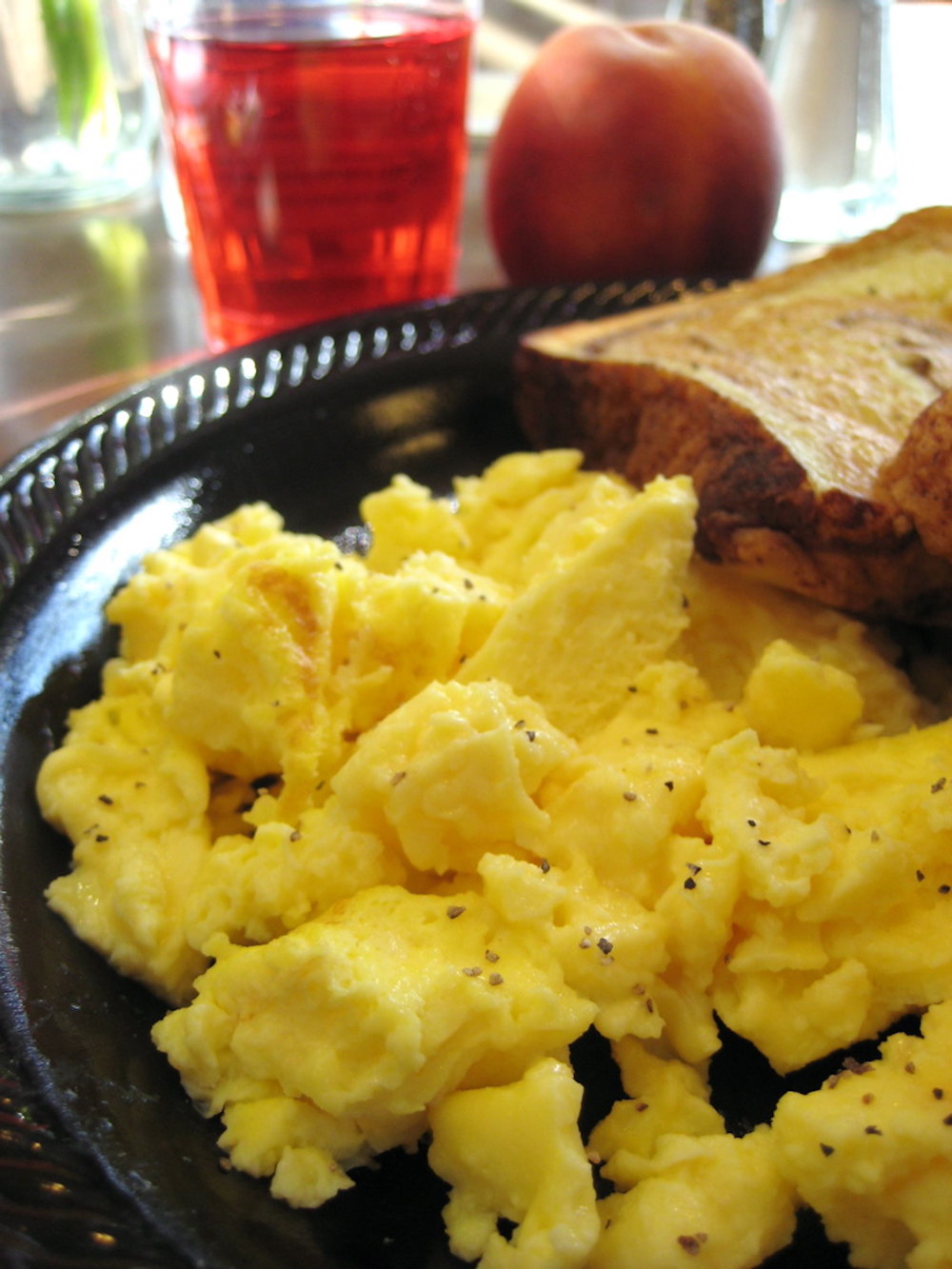 Scrambled eggs and fruit. For fluffier eggs, add water before scrambling. (Annie Mole/Flickr Creative Commons)