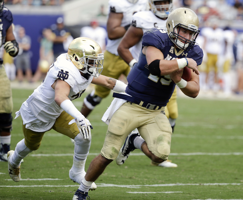 Navy quarterback Will Worth runs for yardage past Notre Dame safety Christopher Schilling, left, during the second half of an NCAA college football game Saturday, Nov. 5, 2016, in Jacksonville, Fla. Navy won 28-27. (John Raoux/AP Photo)