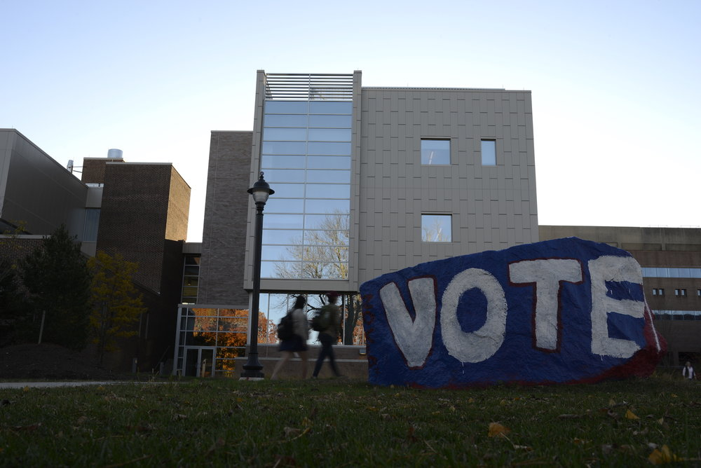 Multiple UConn organizations like UConnPIRG, the Rainbow Center, UConn College Democrats, the African American Cultural Center and the iCenter set up a series of tables on Fairfield Way to encourange students to vote. (Jason Jiang/The Daily Campus)