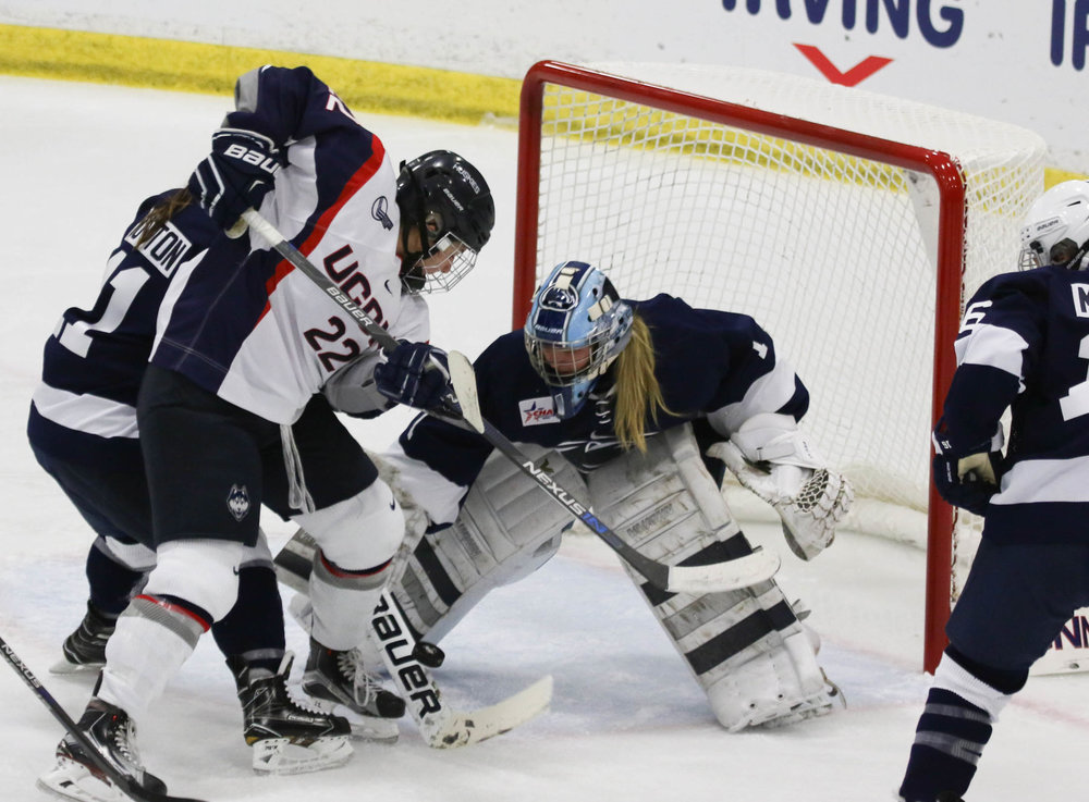 Forward Kelly Harris (22) attempts to score during the Huskies 4-2 victory over Penn State on Oct. 22, 2016 at Freitas Ice Forum. Following the Huskies victory on Tuesday night, the women's record improves to 7-4-1. (Ruohan Li/The Daily Campus)