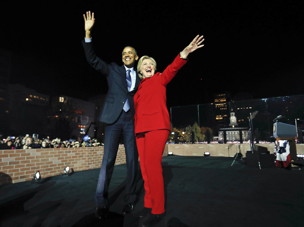 President Barack Obama waves on stage with Democratic presidential candidate Hillary Clinton during a rally at Independence Hall in Philadelphia, Monday, Nov. 7, 2016. (Pablo Martinez Monsivais/AP Photo)