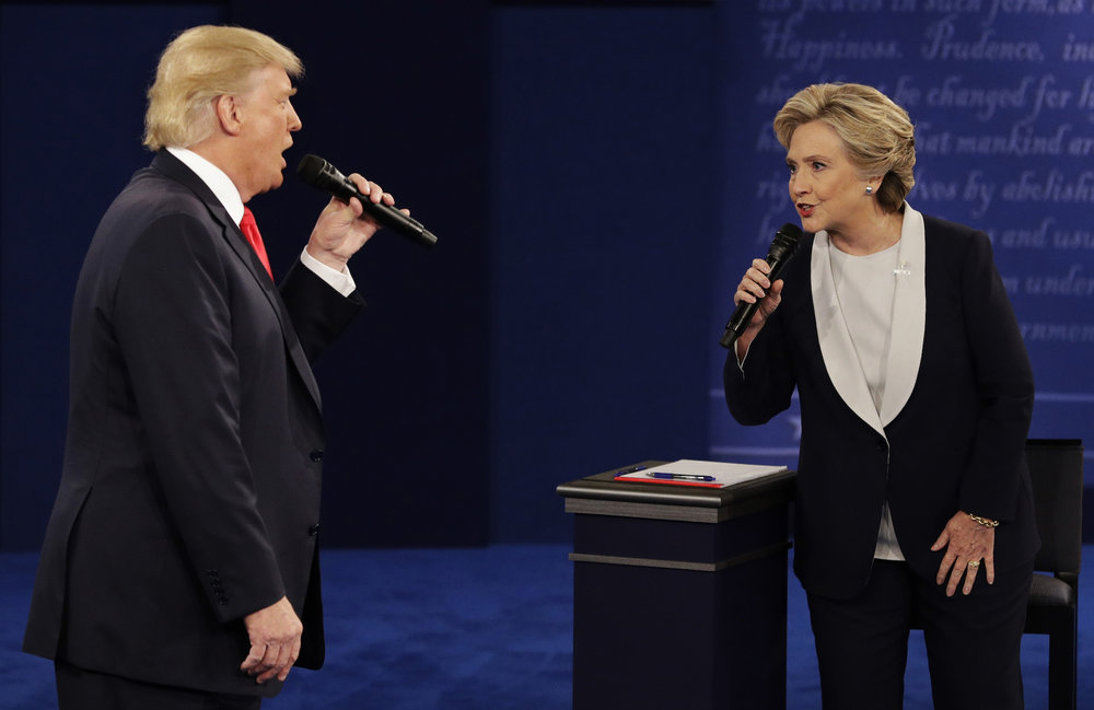 Republican presidential nominee Donald Trump and Democratic presidential nominee Hillary Clinton speak during the second presidential debate at Washington University in St. Louis. (John Locher/AP Photo)