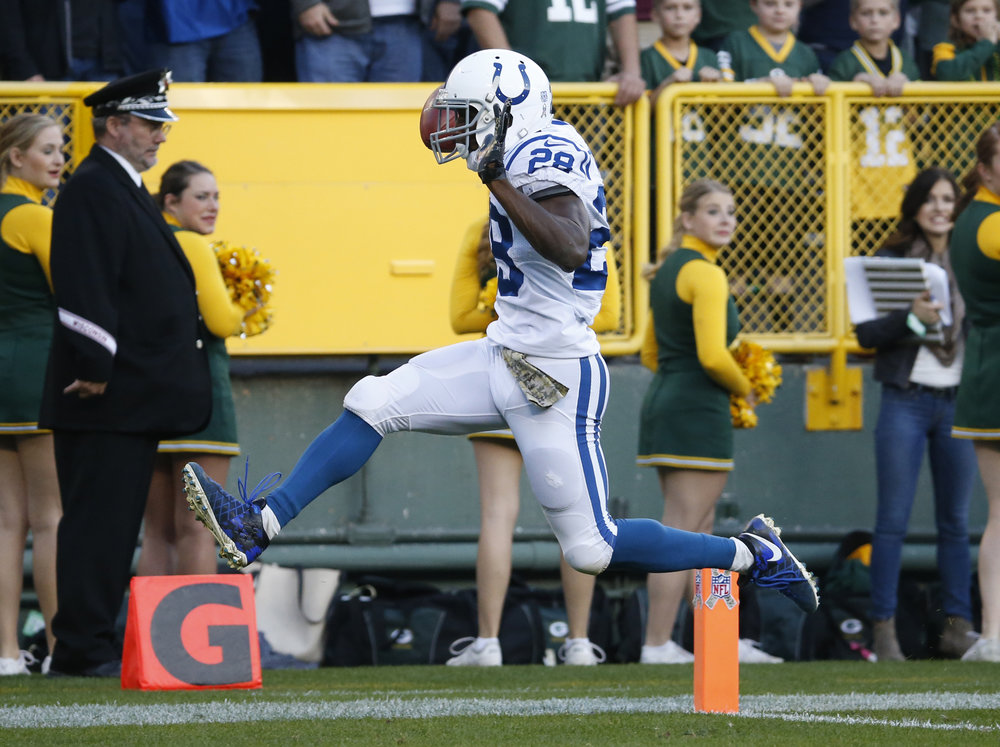 Indianapolis Colts' Jordan Todman (28) celebrates after running back the opening kickoff for a touchdown during the first half of an NFL football game against the Green Bay Packers Sunday, Nov. 6, 2016, in Green Bay, Wis. (Mike Roemer/AP)