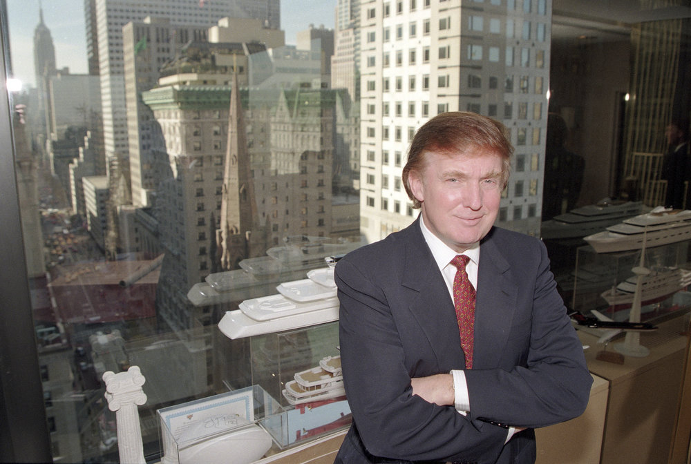 In this Oct. 25, 1996 file photo, real estate magnate Donald Trump poses for a photo in his office in Manhattan borough of New York. (AP Photo/Anders Krusberg)