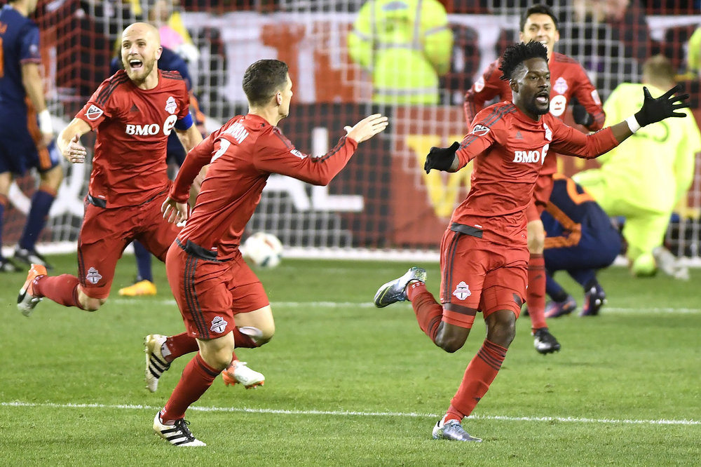 Toronto FC forward Tosaint Ricketts (87), right to left, celebrates his goal with teammates Will Johnson (7) and Michael Bradley (4) during second half MLS soccer playoff action against New York City FC in Toronto, Sunday, Oct. 30, 2016. (Frank Gunn/AP)