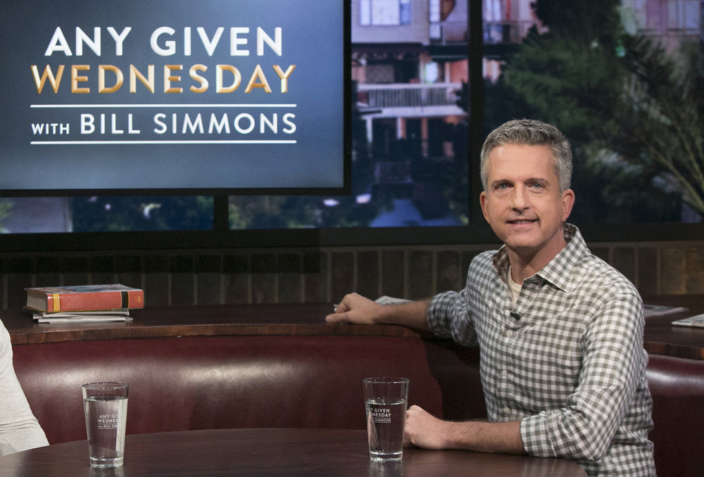 "This image released by HBO shows Bill Simmons on the set of ""Any Given Wednesday with Bill Simmons."" HBO canceled the weekly talk show is ending its run after less than five months. The last episode will air on Nov. 9. (Jordin Althaus/AP)"
