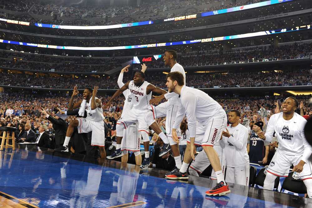 Pictured is Terrence Samuel and team members as UConn's championship win against Kentucky April 5, 2014.  Samuel, now playing for UPenn, is one of the Husky transfers that is now getting court time at their new schools.  (File/ The Daily Campus)