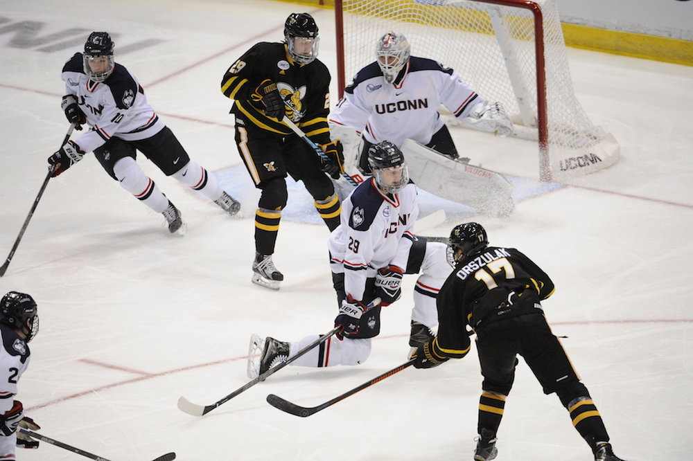 Tage Thompson attempts to block a shot in an October 23rd game against AIC. The two teams tied 2-2. (Jason Jiang/The Daily Campus)
