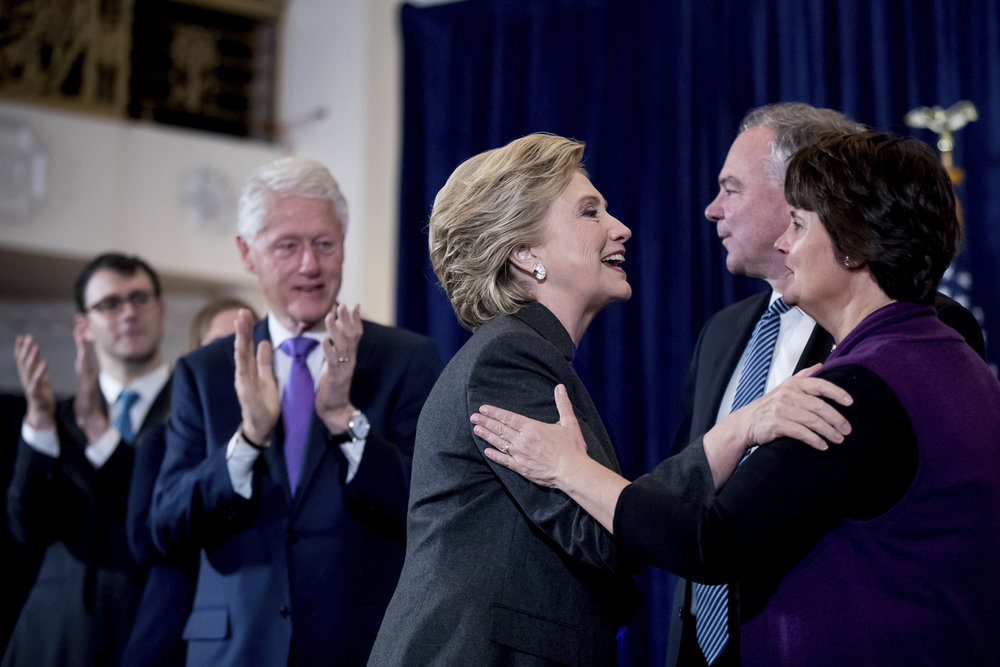 Former President Bill Clinton as his wife, Democratic presidential candidate Hillary Clinton greets her running mate, Democratic vice presidential candidate, Sen. Tim Kaine, D-Va.,and his wife Anne Holton, after speaking at the New Yorker Hotel in New York, Wednesday, Nov. 9, 2016, where she conceded her defeat to Republican Donald Trump after the hard-fought presidential election. (Andrew Harnik/AP)