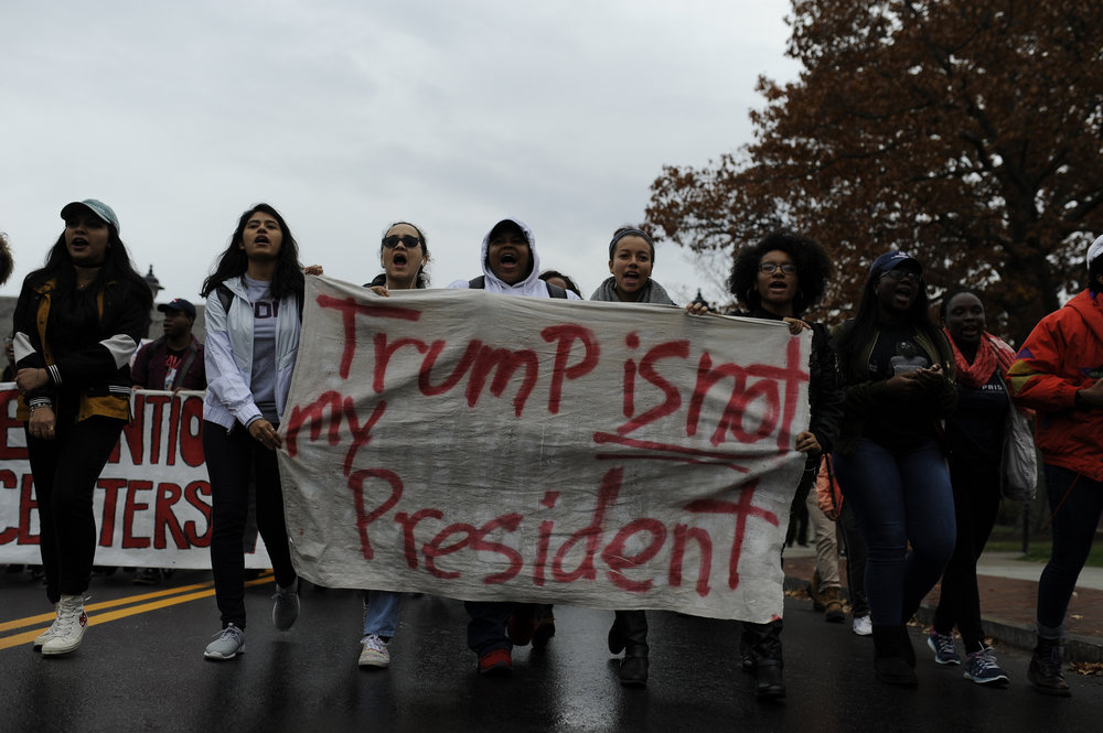Students march down Hillside Road during the Rally for the People on Oct. 10, 2016. (Jason Jiang/The Daily Campus)