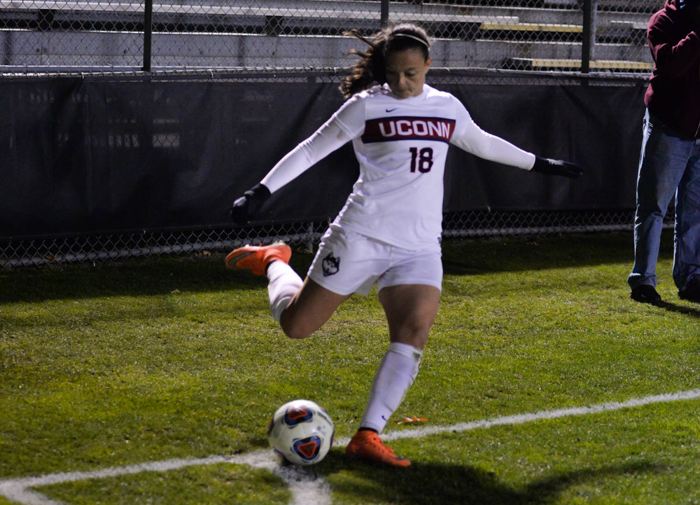 Forward Stephanie Ribeiro (18) prepares a corner kick during the Huskies 4-2 victory over the UAlbany Great Dances on Saturday, Nov. 12, 2016. Ribeiro scored one goal during the game bringing her season total to 21 goals. (Amar Batra/The Daily Campus)