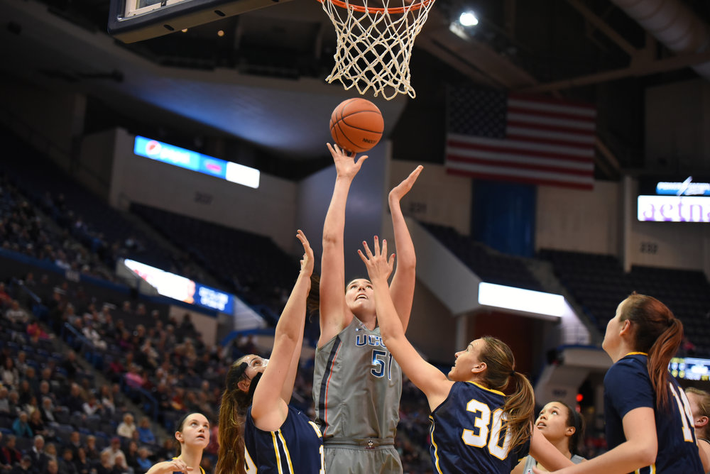 Natalie Butler (51) reaches up for a basket during the Huskies 95-36 victory over Pace University at the XL Center on Nov. 6, 2016. (Zhelun Lan/The Daily Campus)