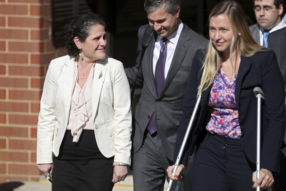 University of Virginia administrator Nicole Eramo, left, leaves the federal courthouse in Charlottesville, Va., with attorney Libby Locke, right, on Friday, Nov. 4, 2016. A federal jury on Friday found Rolling Stone magazine, its publisher and a reporter defamed Eramo in a discredited story about gang rape at a fraternity house of the university. (Ryan M. Kelly /AP)