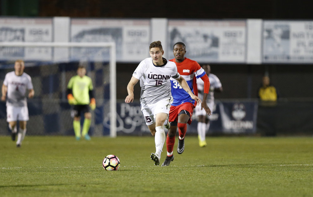 Senior captain Jake Nerwinski (15) drives the ball down the field during the Huskies 1-1 tie against the SMU Mustangs on Saturday, Nov. 5, 2016 at Morrone Stadium. After losing in the semifinals of the AAC tournament the Huskies must now wait to see if they make the NCAA tournament. (Tyler Benton/The Daily Campus)