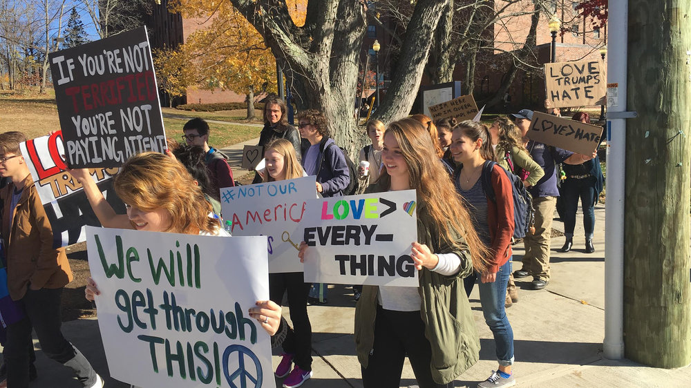 """EO Smith High School student gather in Storrs Center with signs and chants for a """"Love Trumps Hate"""" rally on Monday afternoon. (Chris McDermott/The Daily Campus)"""