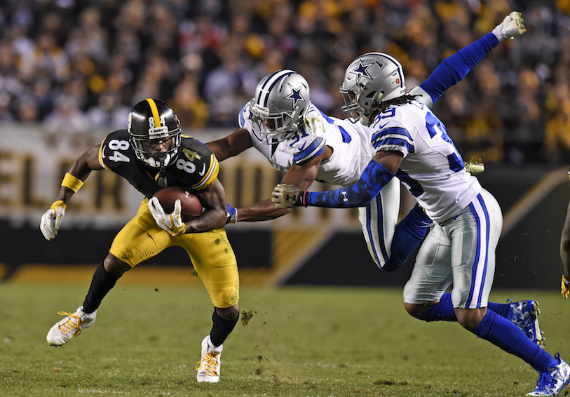 Pittsburgh Steelers wide receiver Antonio Brown (84) is tackled by Dallas Cowboys free safety Byron Jones (31) and Brandon Carr (39) during the second half of an NFL football game in Pittsburgh, Sunday, Nov. 13, 2016. (Don Wright/AP Photo)
