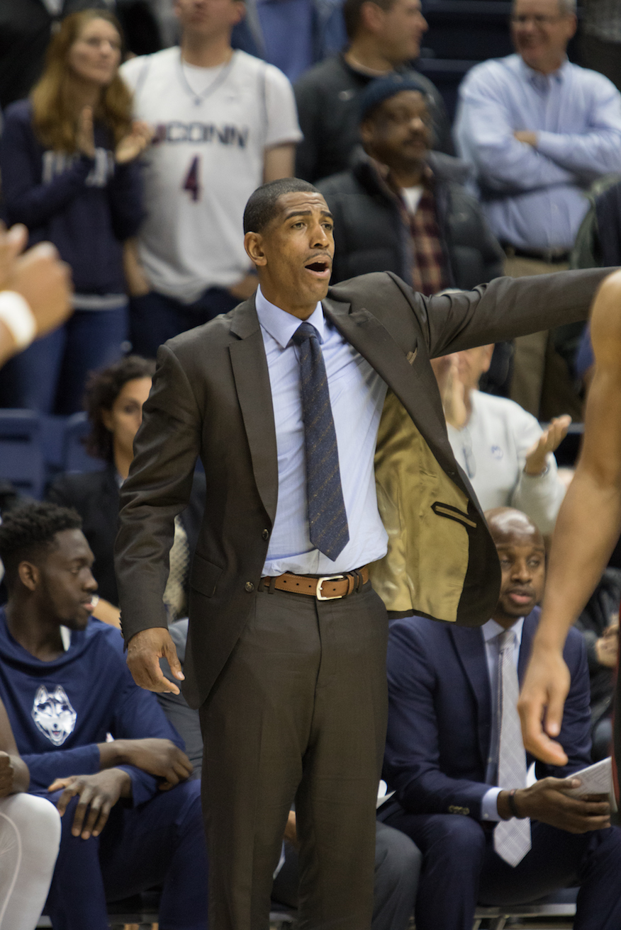 UConn head coach Kevin Ollie looks on as his team drops their second consecutive game to begin the season 0-2 for the first time since 1968. (Jackson Haigis/The Daily Campus)