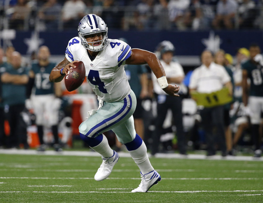 Dallas Cowboys quarterback Dak Prescott scrambles out of the pocket during the team's NFL football game against the Philadelphia Eagles in Arlington, Texas. The Cowboys could have been looking at a repeat of 2015 without Tony Romo, but the fourth-round pick stepped in and they are 7-1. (Michael Ainsworth/AP)