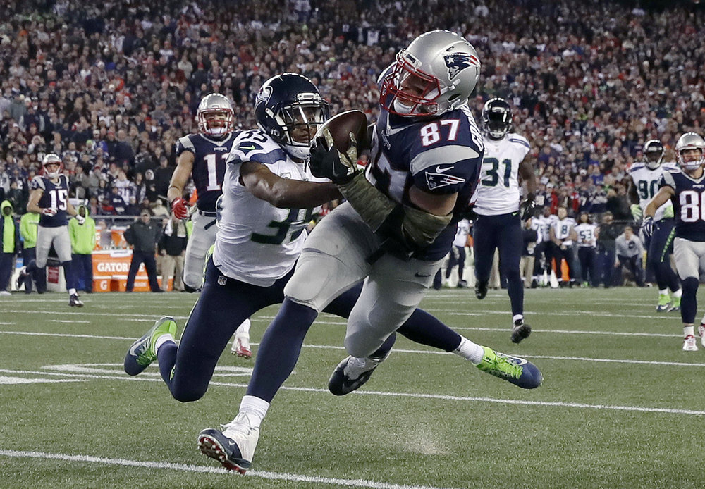New England Patriots tight end Rob Gronkowski (87) catches a pass in front of Seattle Seahawks cornerback DeShawn Shead (35) during the second half of an NFL football game, Sunday, Nov. 13, 2016, in Foxborough, Mass. (Charles Krupa/AP)