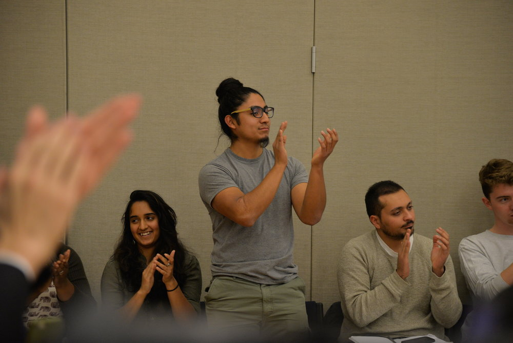 Eric Cruz Lopéz celebrates the passage of a USG bill seeking to make UConn, and the surrounding Mansfield community, into a sanctuary city during the senate's biweekly senate meeting in the Student Union on Wednesday night. (Amar Batra/The Daily Campus)