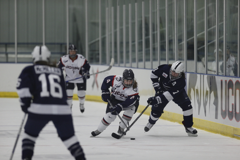 UConn's Cydnee Cook (#4) takes the puck up against Penn State on October 21st. (Tyler Benton/The Daily Campus)