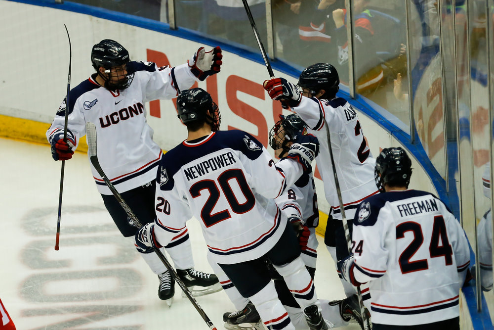 Members of the UConn men's hockey team surround Spencer Naas (8) after his goal in the Huskies' 2-1 loss to Boston College on Nov. 18, 2016 at the XL Center in Hartford, Connecticut.