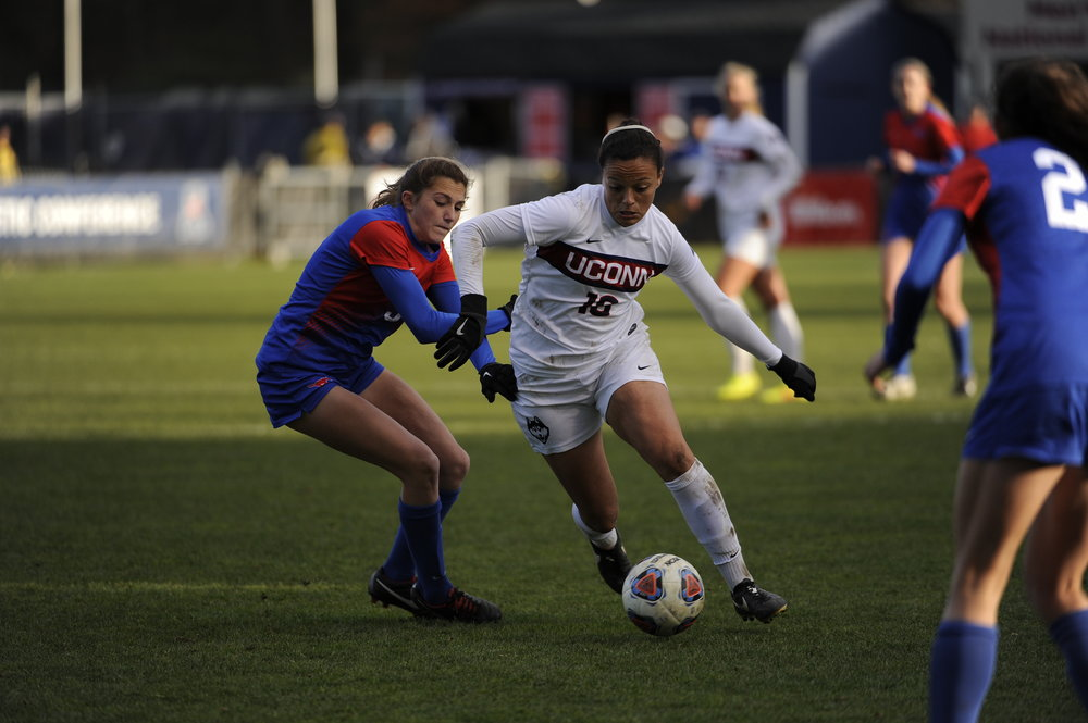 Senior Stephanie Ribeiro battles an SMU defender during the American Athletic Conference championship game on Sunday, Nov. 6, 2016. The Huskies lost to Auburn in the second round of the NCAA tournament on Friday, ending their season. Ribeiro finished with 21 goals, 13 assists and 55 total points, all career highs. (Jason Jiang/The Daily Campus)