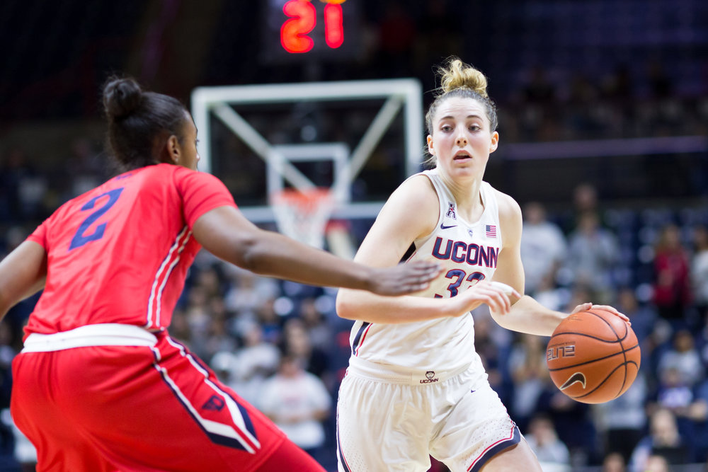 Katie Lou Samuelson dribbles past Dayton's Jordan Wilmoth in the Huskies' 98-65 win over the Flyers on Nov. 22, 2016 at Gampel Pavilion. (Tyler Benton/The Daily Campus)