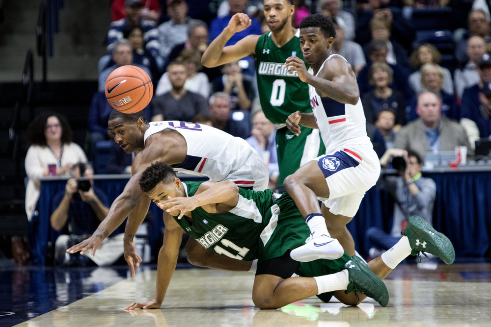 UConn guards Rodney Purvis and Alterique Gilbert lunge for the ball during a 67-58 loss to Wagner on Nov. 11 at Gampel Pavilion in Storrs. (Jackson Haigis/The Daily Campus)