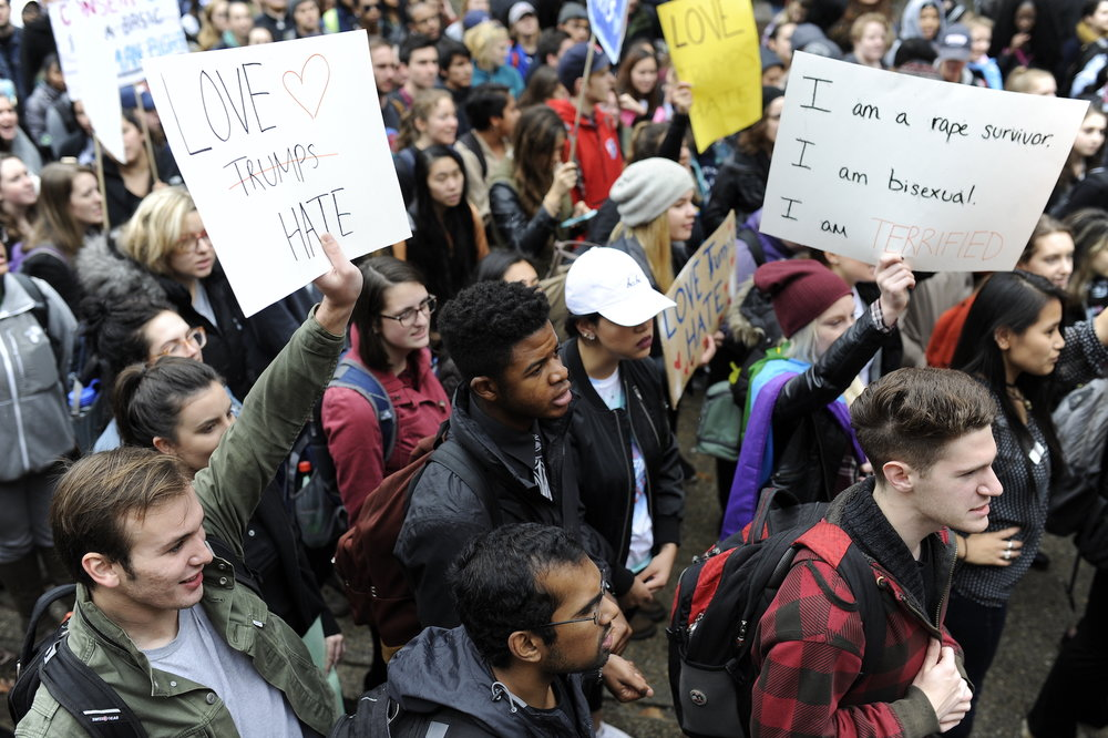 Students at the Nov. 9 Rally for the People stand together against hate. UConn students rally against Trump to show UConn as a community will denounce the racism, xenophobia, and sexism. (Jason Jiang/The Daily Campus)