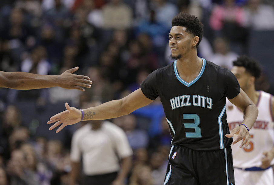 Charlotte Hornets' Jeremy Lamb (3) is congratulated by a teammate after making a basket against the New York Knicks in the second half of an NBA basketball game in Charlotte, N.C., Saturday, Nov. 26, 2016. (AP Photo/Chuck Burton)