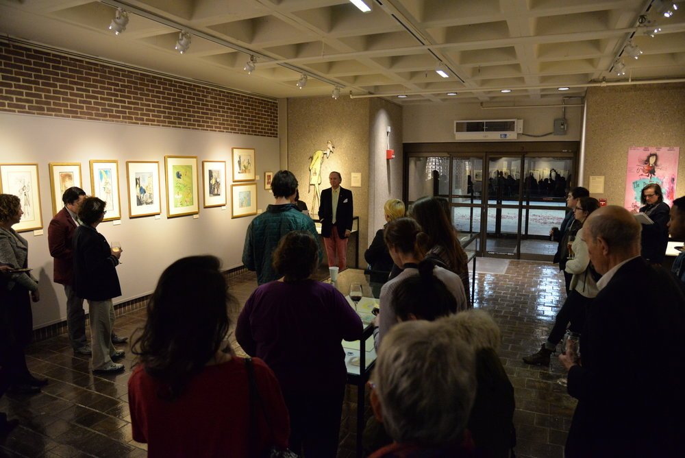 People gather in the library to view an exhibition featuring art of the cartoonist Ronald Searle in Homer Babbidge Library on Monday, Nov. 28. Speakers included author Robert Forbes, Cora Lynn Deibler and Alison Paul from the School of Fine Arts. (Amar Batra/The Daily Campus)