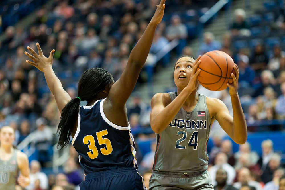 Sophomore Napheesa Collier going for a shot against Chatanooga's  junior Aryanna Gilbert at the Nov. 29 game at the XL Center. (Tyler Benton/The Daily Campus)