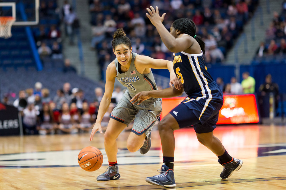 Junior Kia Nurse dribbling down the court in Huskies game Nov. 29 at the XL Center against Chatanooga.  Huskies won with a score of 80-43 for their 80th-straight victory.  (Tyler Benton/The Daily Campus)