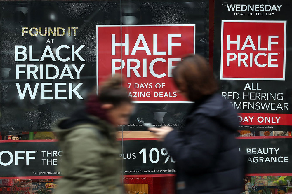 A shop in Basingstoke, England is advertising its discounts for the Black Friday shopping event on Wednesday, Nov. 23, 2016. Imported from the U.S., Black Friday sales have become an increasingly important period for British retailers ahead of Christmas. (Andrew Matthews/AP)
