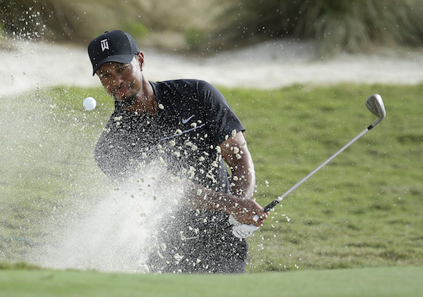 Tiger Woods hits from a bunker onto the 14th green during the first round at the Hero World Challenge golf tournament, Thursday, Dec. 1, 2016, in Nassau, Bahamas. Woods is one-over-par for the round. (Lynne Sladky/AP Photo)