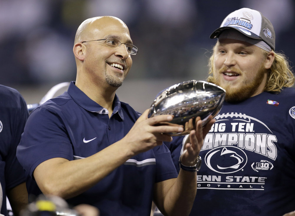 Penn State head coach James Franklin holds the trophy in front of defensive lineman Derek Dowrey after defeating Wisconsin to win the Big Ten championship NCAA college football game in Indianapolis on Dec. 4th 2016. (AJ Mast/AP Exchange)