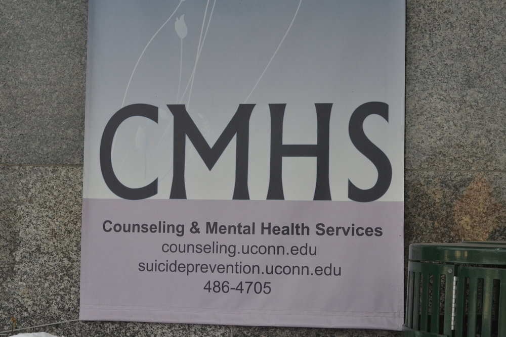 A sign advertising CMHS as a resource for students. (File/The Daily Campus)