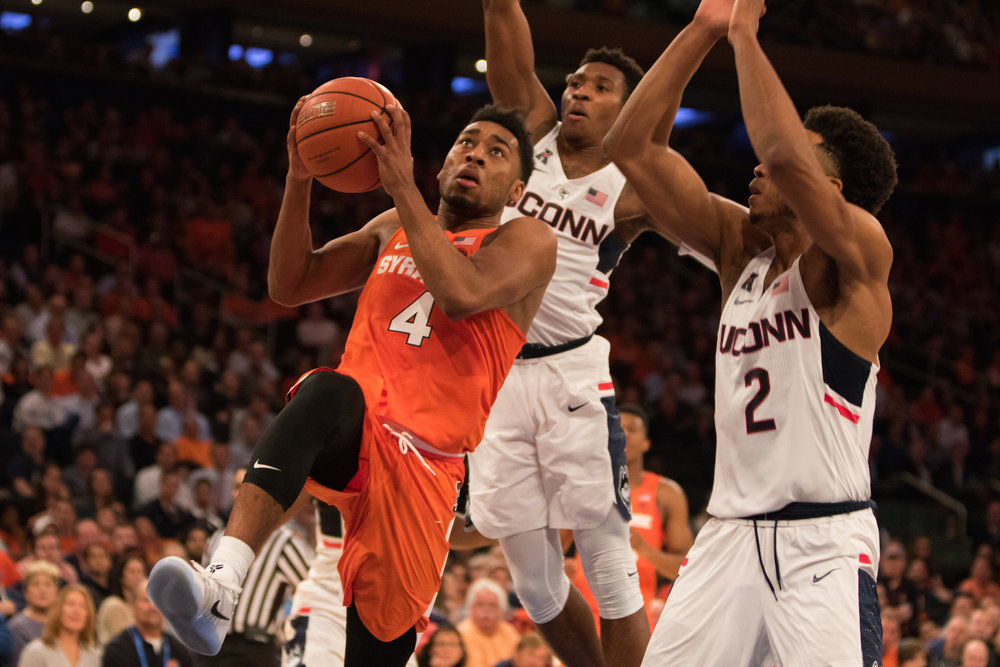 UConn guards Christian Vital and Jalen Adams defend against Syracuse guard John Gillon in the first half. UConn beat Syracuse at MSG on Monday, Dec. 5, 2016. (Jackson Haigis/The Daily Campus)